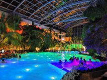 Therme Bucharest, Palm Zone in the night. Indoor pool with thermal water and colorful lights royalty free stock photo