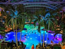 Therme Bucharest, Palm Zone in the night. Indoor pool with thermal water and colorful lights underwater royalty free stock photography