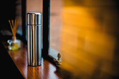 Thermo flask in the kitchen with decoration Royalty Free Stock Image