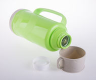 Thermo, Plastic Thermo flask on background. Stock Photos