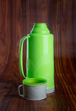 Thermo, Plastic Thermo flask on background. Royalty Free Stock Photography