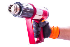 Thermoelectric gun in hand Stock Photo