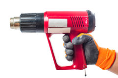Thermoelectric gun in man's hand Stock Photos