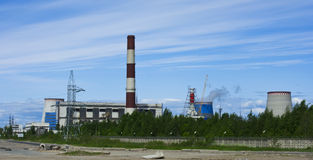 Thermoelectric plant. Thermal Power Plant in the background of blue sky in the green thicket Royalty Free Stock Image