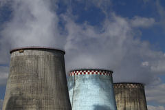 Thermoelectric plant against the blue sky Stock Image