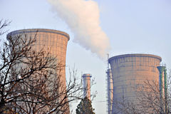 Thermoelectric plant cooling towers with smoke Stock Photo