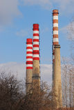 Thermoelectric power plant chimneys. Four painted thermoelectric power plant's high chimneys stock photo