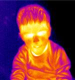 Thermograph-Boy portrait. Young boy portrait. Real infrared (thermic) photo in blue Royalty Free Stock Photography