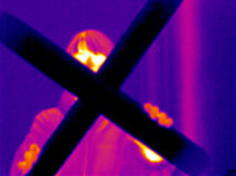 Thermograph-Man with cross. Man holding a big crucifix. Real infrared (thermic) photo Royalty Free Stock Photo