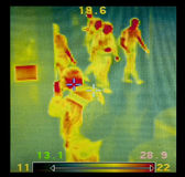 Thermographic image. Witm me, in the first plane photographing and several people in the background Royalty Free Stock Photo