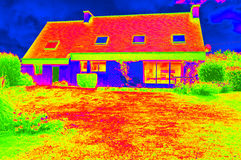 Thermographic picture of a house. Thermorgraphic picture of a single house with roof and windows Stock Photo