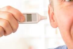 Thermomètre d'oreille Photos stock