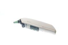Thermomètre d'oreille de Digitals Photographie stock libre de droits