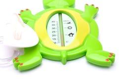 Thermomètre de bébé sur le fond blanc Images libres de droits