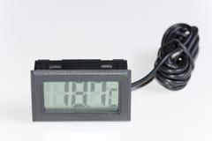 Thermomètre numérique en plastique noir Photographie stock libre de droits