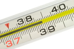 The thermometer. Thermometer (shows high temperature). A scale and figures. Isolated over white Royalty Free Stock Photo