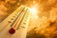 Thermometer. In the sky, the heat Royalty Free Stock Images