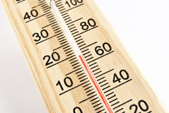 Thermometer. Studio shot of a wooden thermometer Royalty Free Stock Photos