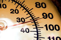 Thermometer at 92. Ninety-two degrees Fahrenheit - it is hot outside! Thermometer shows summer heat royalty free stock photography