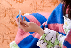 Thermometer against the couch Stock Images