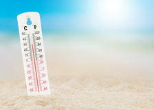Thermometer on beach. Concept world hot stock image