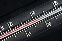 Thermometer on a black background. Particularly close to a thermometer Stock Photo