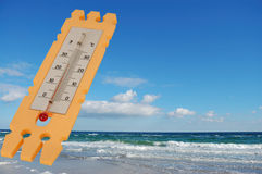 Thermometer on blue sky background Stock Photo