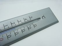 Thermometer calibrated in degrees celsius on white background royalty free stock images