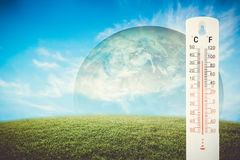 Thermometer check the earth& x27;s temperature with impact of global. Thermometer check the earth& x27;s temperature with impact of global environment concept Stock Images