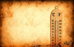 Thermometer on Grunge old paper texture Royalty Free Stock Images