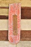 Thermometer on grunge wood Royalty Free Stock Images