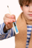 The thermometer in a hand of the boy Royalty Free Stock Image