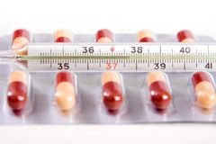 Thermometer heat temperature and pills capsules Stock Photography