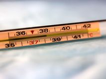 Thermometer with high temperature on blue background stock images