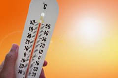 Thermometer with hot temperature Stock Photo