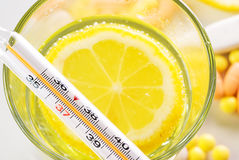 Thermometer and lemon Royalty Free Stock Photography