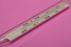 Thermometer. Medical thermometer on a colored background Stock Image