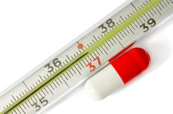 Thermometer medical with pill Royalty Free Stock Photos