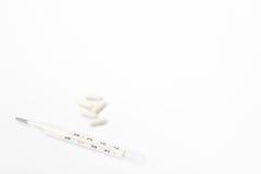 Thermometer mit weißen Kapseln Lizenzfreie Stockbilder