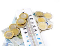 Thermometer and money isolated on white background Stock Photography