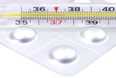 Thermometer and pills Royalty Free Stock Image