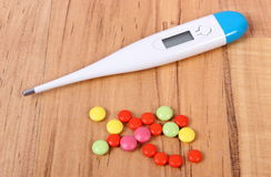 Thermometer and pills for colds, treatment of flu and runny Royalty Free Stock Photo