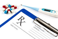 Thermometer with pills and RX form, Fever headache Royalty Free Stock Images