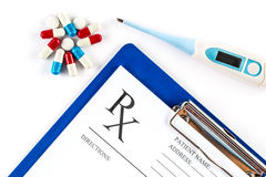Thermometer with pills and RX form, Fever headache Royalty Free Stock Photo