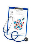 Thermometer with pills Stethoscope and RX form Stock Photo