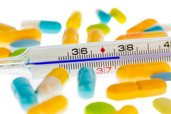 Thermometer and pills Royalty Free Stock Photos