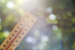 Thermometer pointing to the sky to symbolize the heat of summer.  royalty free stock photo