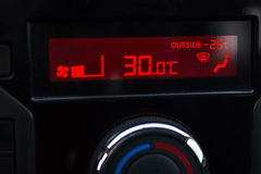 Thermometer shows minus 25 in car. Control panel in winter season Stock Image