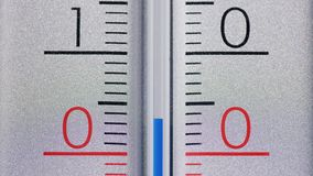 The thermometer shows a sharp cooling below zero degrees Celsius. Winter and cold season stock photos
