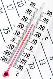 Thermometer sitting on a calendar sheet Stock Photos